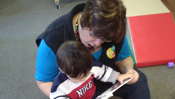Tile_anne_reading_to_child